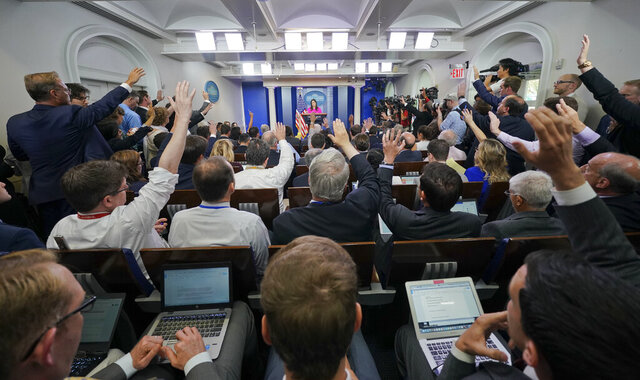 "FILE - Oct. 10, 2017, file photo, journalists raise their hands in the White House press room during the daily briefing, in Washington. China is denouncing a move by the Trump administration to cap the number of journalists from five Chinese state-run media outlets in the United States as ""based on the Cold War mentality and ideological prejudice."