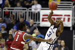 Butler guard Kamar Baldwin (3) passes over Stanford guard Tyrell Terry (3) during the first half of an NCAA college basketball game, Tuesday, Nov. 26, 2019, in Kansas City, Mo. (AP Photo/Charlie Riedel)