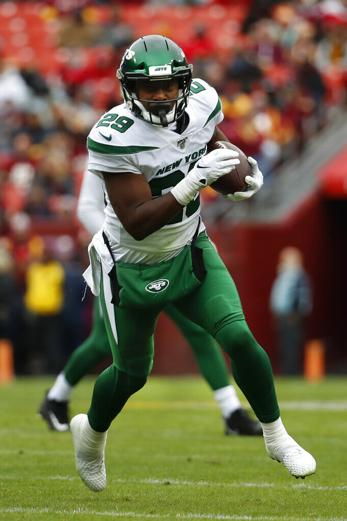 New York Jets running back Bilal Powell (29) runs with the ball against the Washington Redskins in the first half of an NFL football game, Sunday, Nov. 17, 2019, in Landover, Md. (AP Photo/Alex Brandon)