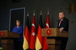 Germany's Chancellor Angela Merkel, left, looks at Turkey's President Recep Tayyip Erdogan, right, during a joint news conference following their meeting in Istanbul, Friday, Jan. 24, 2020. Merkel met Erdogan for talks that are expected to focus on the future of a migration deal between Turkey and the EU that helped decrease refugee flows to Europe.(AP Photo/Emrah Gurel)