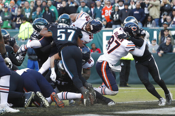 Chicago Bears' David Montgomery (32) scores a touchdown against Philadelphia Eagles' T.J. Edwards (57) during the second half of an NFL football game, Sunday, Nov. 3, 2019, in Philadelphia. (AP Photo/Chris Szagola)