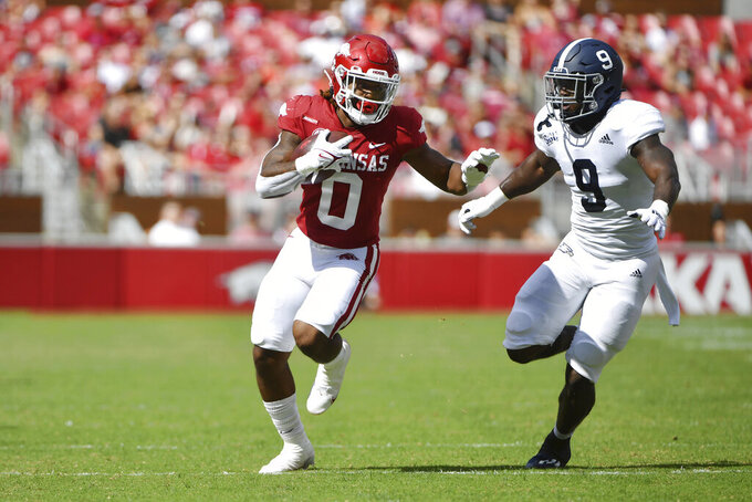 A rkansas running back AJ Green (0) runs past Georgia Southern linebacker Khadry Jackson (9) during the first half of an NCAA college football game Saturday, Sept. 18, 2021, in Fayetteville, Ark. (AP Photo/Michael Woods)
