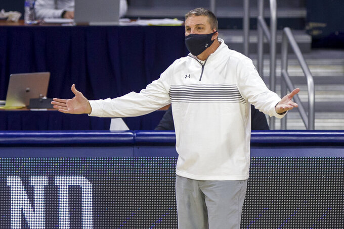 Boston College head coach Jim Christian questions a call during the first half of an NCAA college basketball game against Notre Dame, Saturday, Jan. 16, 2021, in South Bend, Ind. (AP Photo/Robert Franklin)
