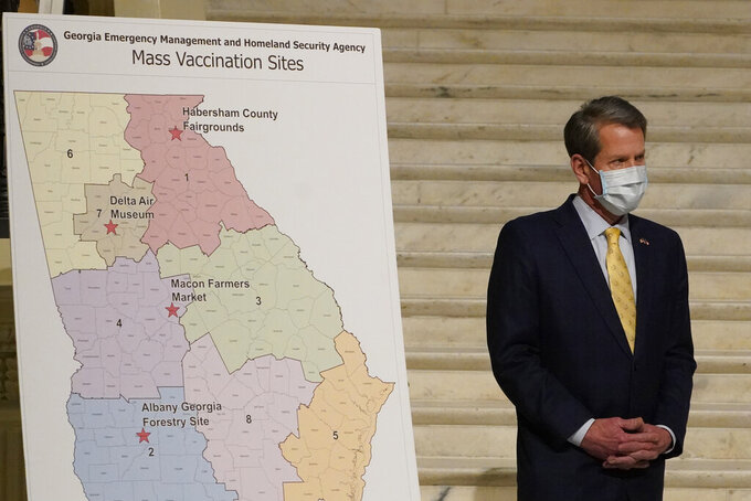 Georgia Gov. Brian Kemp answers questions during a news conference to discuss the state's COVID-19 vaccine distribution plans, Thursday, Feb. 18, 2021, in Atlanta. (AP Photo/John Bazemore)