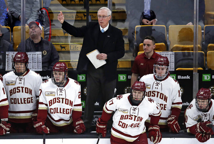 Boston College head coach Jerry York calls to his players during the first period of the NCAA hockey Beanpot tournament championship game against Northeastern in Boston, Monday, Feb. 11, 2019. Boston College announced they signed hockey coach York to a contract extension. The school said on Monday that the five-time NCAA champion received a multi-year deal. York is college hockey's all-time winningest coach with 1,063 career victories. (AP Photo/Charles Krupa)