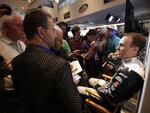 Kevin Harvick, right, talks with reporters during media day for the NASCAR Daytona 500 auto race at Daytona International Speedway, Wednesday, Feb. 14, 2018, in Daytona Beach, Fla. (AP Photo/John Raoux)