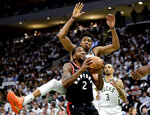 Toronto Raptors forward Kawhi Leonard (2) gets fouled by Milwaukee Bucks forward Giannis Antetokounmpo (34) during the second half in Game 1 of the NBA basketball playoffs Eastern Conference final in Milwaukee on Wednesday, May 15, 2019. (Frank Gunn/The Canadian Press via AP)