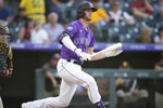 Colorado Rockies' Ryan McMahon reacts after striking out against San Diego Padres starting pitcher Dinelson Lamet in the second inning of a baseball game Monday, June 14, 2021, in Denver. (AP Photo/David Zalubowski)