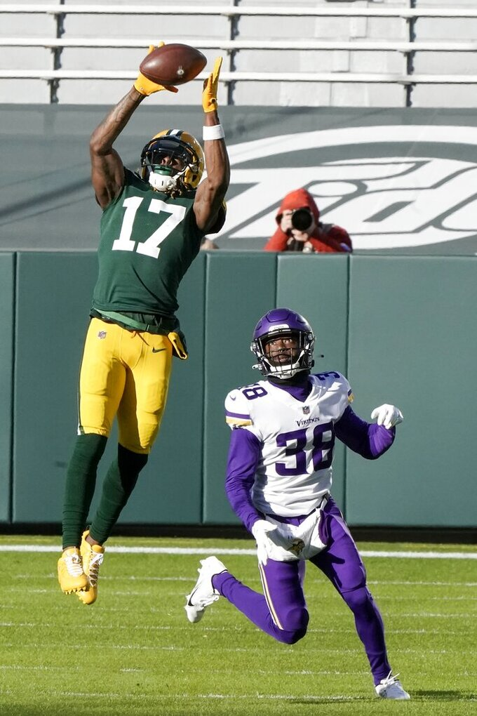 Green Bay Packers' Davante Adams catches a pass in front of Minnesota Vikings' Harrison Hand during the second half of an NFL football game Sunday, Nov. 1, 2020, in Green Bay, Wis. (AP Photo/Morry Gash)