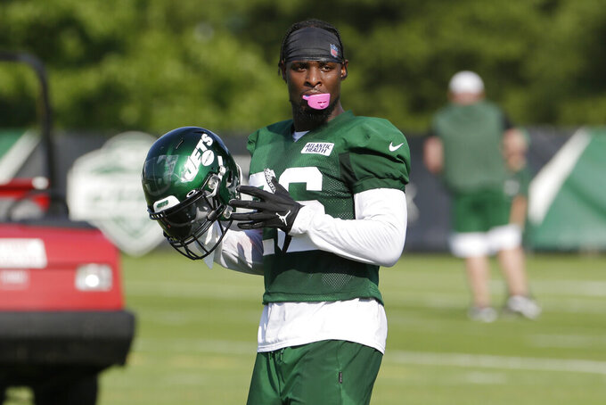 FILE - In this July 25, 2019, file photo, New York Jets running back Le'Veon Bell participates during practice at the NFL football team's training camp in Florham Park, N.J. Bell's debut with the New York Jets will not come until the regular season after Adam Gase announced the star running back will be held out of the final two preseason games. Gase says Sunday, Aug. 18, he was leaning toward that decision, but a season-ending knee injury to linebacker Avery Williamson in the Jets' preseason loss at Atlanta on Thursday night sealed it. (AP Photo/Seth Wenig, File)