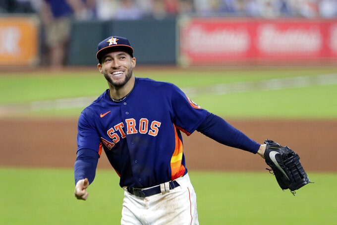 FILE - Houston Astros' George Springer reacts after a 3-2 win against the Arizona Diamondbacks in the last regular season home baseball game, in Houston, in this Sunday, Sept. 20, 2020, file photo. Springer hit two home runs during the game. Spring is a free agent. (AP Photo/Michael Wyke, File)