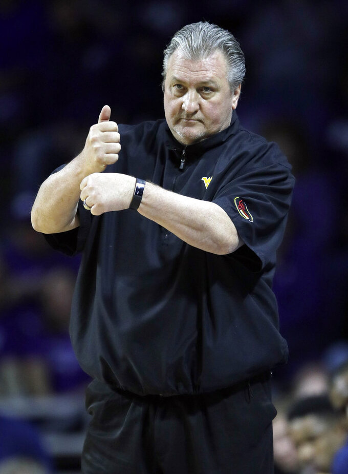 West Virginia coach Bob Huggins calls a play during the first half of the team's NCAA college basketball game against Kansas State in Manhattan, Kan., Wednesday, Jan. 9, 2019. (AP Photo/Orlin Wagner)