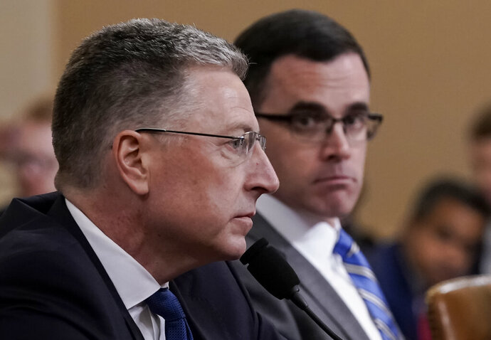 Ambassador Kurt Volker, left, former special envoy to Ukraine, and Tim Morrison, a former official at the National Security Council, testify before the House Intelligence Committee on Capitol Hill in Washington, Tuesday, Nov. 19, 2019, during a public impeachment hearing of President Donald Trump's efforts to tie U.S. aid for Ukraine to investigations of his political opponents. (AP Photo/J. Scott Applewhite)
