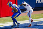 Los Angeles Rams tight end Tyler Higbee, left, catches a pass in front of Buffalo Bills' Jaquan Johnson, right, to score on the point after try during the second half of an NFL football game Sunday, Aug. 26, 2018, in Orchard Park, N.Y. (AP Photo/John Munson)
