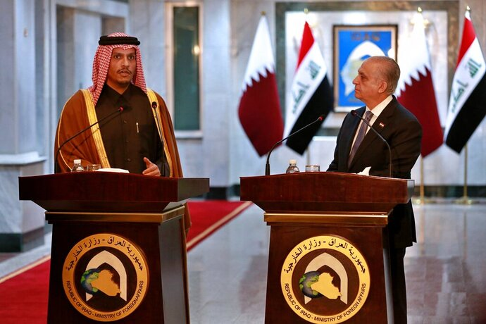 Iraqi Foreign Minister Mohamed Alhahkim, right, holds a press conference with visiting Qatari counterpart Sheikh Mohammed bin Abdulrahman Al Thani in Baghdad, Iraq, Wednesday, Jan. 15, 2020. (AP Photo/Khalid Mohammed)