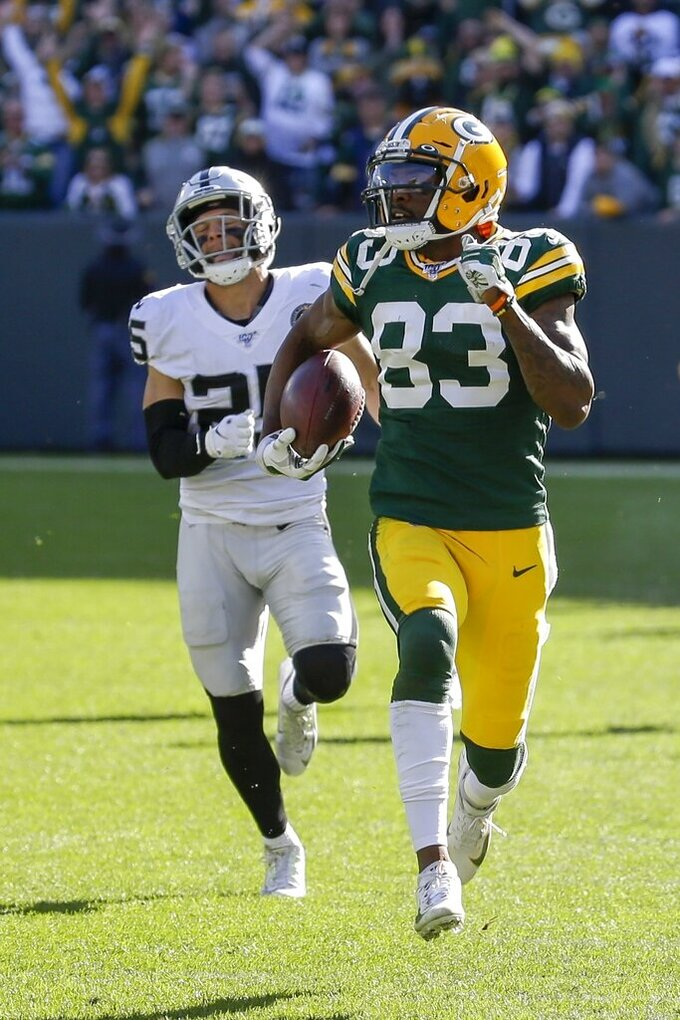 Green Bay Packers' Marquez Valdes-Scantling breaks away for a touchdown during the second half of an NFL football game against the Oakland Raiders Sunday, Oct. 20, 2019, in Green Bay, Wis. (AP Photo/Mike Roemer)