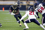 New Orleans Saints running back Alvin Kamara (41) carries against Houston Texans cornerback Bradley Roby (21) in the first half of an NFL football game in New Orleans, Monday, Sept. 9, 2019. (AP Photo/Bill Feig)