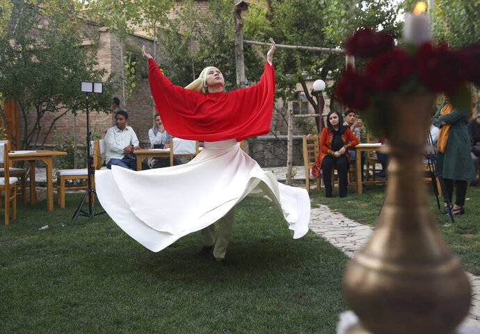 Fahima Mirzaie performs a Sema dance (Sufi Whirling) in Kabul Afghanistan, Thursday, Aug. 20, 2020. Taking on an unorthodox task in her society, the 24-year-old teaches men and women Sufi whirling. Mirzaie spins alongside men at an Afghan Italian restaurant in center of the capital, Kabul. (AP Photo/Mariam Zuhaib)