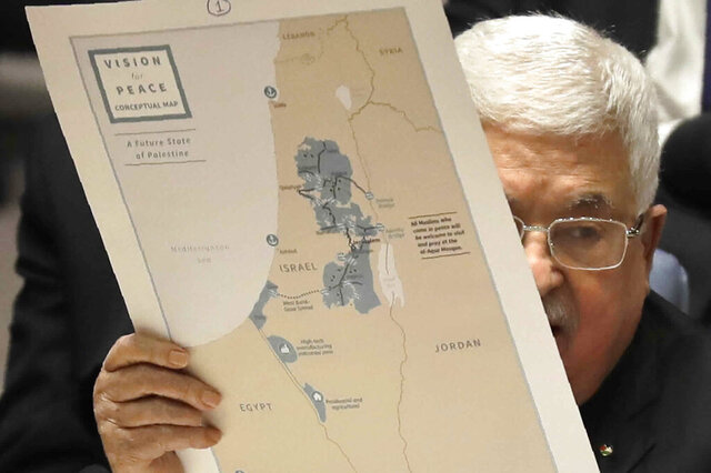FILE - In this Feb. 11, 2020 file photo, Palestinian President Mahmoud Abbas holds a map as he speaks during a Security Council meeting at United Nations headquarters. In three decades of failed peace efforts, the Palestinians' hopes for an independent state in the territories Israel seized in the 1967 war have never seemed so dim. But there's no indication their aging leadership will change course. Abbas remains committed to the same strategy he has pursued for decades — seeking international support to pressure Israel to agree to a Palestinian state in the West Bank, Gaza and east Jerusalem. (AP Photo/Seth Wenig, File)