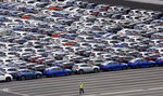 In this July 8, 2019, photo, cars for export are parked at Kawasaki port, near of Tokyo. Japan has logged a third straight month of a trade deficit in September, according to the latest government data, as trade tensions between China and the U.S. crimped exports. Japan's Finance Ministry reported Monday, Oct. 21, the nation's trade deficit in September totaled 122.98 billion yen ($1.13 billion). (AP Photo/Koji Sasahara)