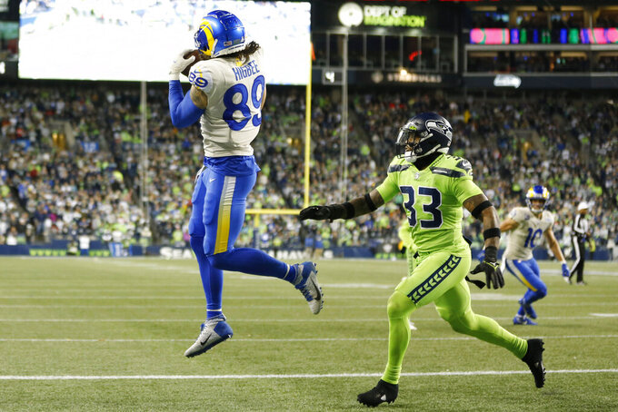 Los Angeles Rams tight end Tyler Higbee (89) makes a catch for a touchdown near Seattle Seahawks safety Jamal Adams, right, during the second half of an NFL football game, Thursday, Oct. 7, 2021, in Seattle. (AP Photo/Craig Mitchelldyer)