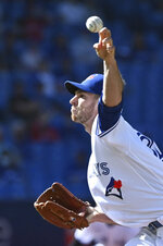 Toronto Blue Jays' Steven Matz pitches in the first inning of a baseball game against the Minnesota Twins in Toronto on Saturday, Sept. 18, 2021. (Jon Blacker/The Canadian Press via AP)