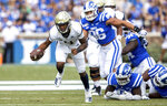 Georgia Tech's Robert Nelson (4) carries the ball past the Duke defense during an NCAA college football game in Durham, N.C., Saturday, Oct. 12, 2019. (AP Photo/Ben McKeown)