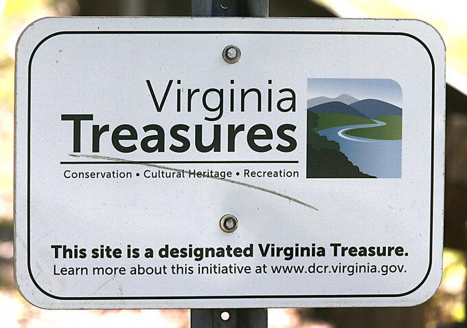 A sign near the Grapevine Bridge across the Chicahominy River outside of Sandston, Va. Thursday, July 15, 2021. (Bob Brown/Richmond Times-Dispatch via AP)
