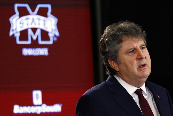 FILE - In this Jan. 10, 2020 file photo, Mississippi State NCAA college football coach Mike Leach speaks at a news conference at the Starkville, Miss., based university, after being officially introduced as the head coach. The coronavirus pandemic has shut down much of Division I football, but with three of the Power Five leagues still playing, there are still some big games to look forward to.  Mississippi State will verse Mississippi on Nov. 28, 2020.  (AP Photo/Rogelio V. Solis, File)