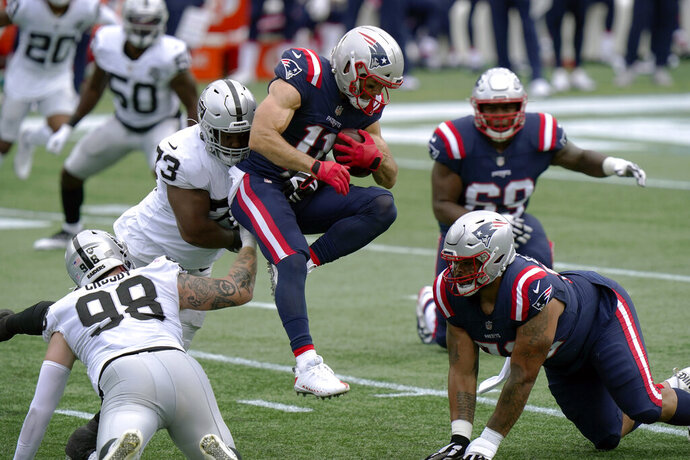 Las Vegas Raiders defensive lineman Maurice Hurst (73) tackles New England Patriots wide receiver Julian Edelman (11) in the first half of an NFL football game, Sunday, Sept. 27, 2020, in Foxborough, Mass. (AP Photo/Steven Senne)
