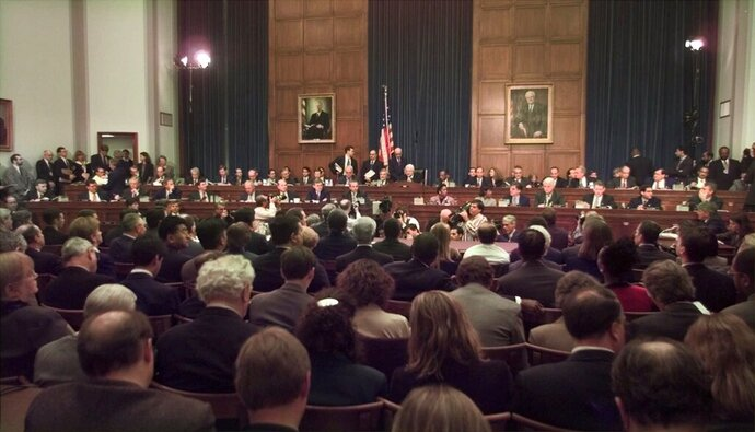 FILE - In this Nov. 19, 1998 file photo, House Judiciary Committee Chairman Rep. Henry Hyde, R-Ill., presides over the committee's impeachment hearing for President Bill Clinton, on Capitol Hill in Washington. The public impeachment inquiry hearings this week usher in a rare and momentous occasion in American history as Congress debates whether to remove a sitting president from office. (AP Photo/Joe Marquette, File)