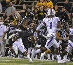Southern Mississippi running back Don Ragsdale jumps over the Louisiana Tech defense during an NCAA college football game in Hattiesburg, Miss., Saturday, Sept. 19, 2020. (Cam Bonelli/Hattiesburg American via AP)