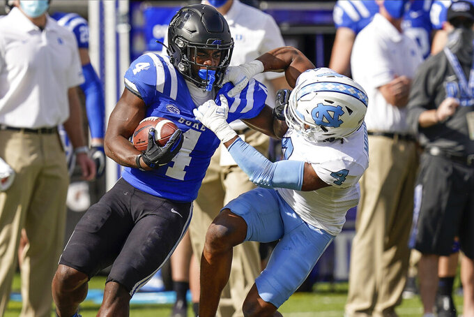 North Carolina defensive back Trey Morrison (4) brings down Duke running back Deon Jackson (4) during the first half of an NCAA college football game at Wallace Wade Stadium, Saturday, Nov. 7, 2020, in Durham, N.C. (Jim Dedmon/Pool Photo via AP)