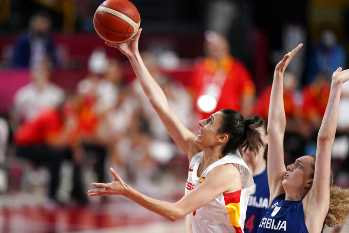 Spain's Alba Torrens drives to the basket past Serbia's Aleksandra Crvendakic, right, during a women's basketball preliminary round game at the 2020 Summer Olympics, Thursday, July 29, 2021, in Saitama, Japan. (AP Photo/Charlie Neibergall)