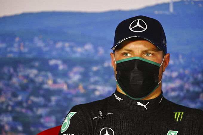 Mercedes driver Valtteri Bottas of Finland talks during a press conference after the qualifying session for the Hungarian Formula One Grand Prix at the Hungaroring racetrack in Mogyorod, Hungary, Saturday, July 18, 2020. The Hungarian F1 Grand Prix will be held on Sunday. (Mark Sutton/Pool Via AP)
