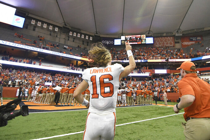 Clemson quarterback Trevor Lawrence leaves the field after the team's 41-6 win over Syracuse during an NCAA college football game Saturday, Sept. 14, 2019, in Syracuse, N.Y. (AP Photo/Steve Jacobs)