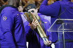 LSU quarterback Joe Burrow kisses the national championship trophy during a celebration of their NCAA college football championship, Saturday, Jan. 18, 2020, on the LSU campus in Baton Rouge, La. (AP Photo/Gerald Herbert)