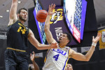 Missouri forward Reed Nikko (14) and LSU guard Skylar Mays (4) battle for a rebound in the first half of an NCAA college basketball game, Tuesday, Feb. 11, 2020, in Baton Rouge, La. LSU won 82-78. (AP Photo/Bill Feig)