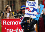 Protestors demonstrate in front of the Houses of Parliament in London, Wednesday, March 6, 2019. Britain's chief law officer said Wednesday that Brexit negotiations with the European Union had got to