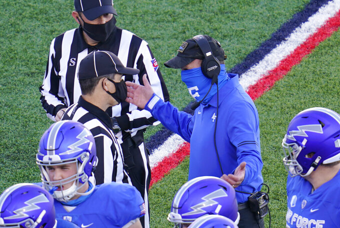 Air Force head coach Troy Calhoun, top right, argues with referees for a call in the first half of an NCAA college football game against Boise State, Saturday Oct. 31, 2020, at Air Force Academy, Colo. (AP Photo/David Zalubowski)