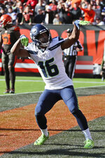 Seattle Seahawks wide receiver Tyler Lockett celebrates after a 16-yard touchdown during the second half of an NFL football game against the Cleveland Browns, Sunday, Oct. 13, 2019, in Cleveland. (AP Photo/Ron Schwane)