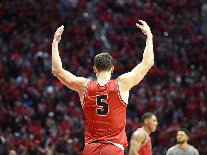 San Diego State forward Yanni Wetzell (5) celebrates after scoring during the second half of an NCAA college basketball game against Nevada Saturday, Jan. 18, 2020, in San Diego. (AP Photo/Denis Poroy)