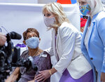First lady Jill Biden embraces a person receiving a vaccine speak as she visits the Abyssinian Baptist Church in the Harlem neighborhood of New York, Sunday, June 6, 2021. (AP Photo/Craig Ruttle)