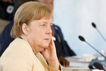 German Chancellor Angela Merkel attends a plenary session during the G7 summit in Carbis Bay, England, Sunday June 13, 2021. (Phil Noble/Pool via AP)