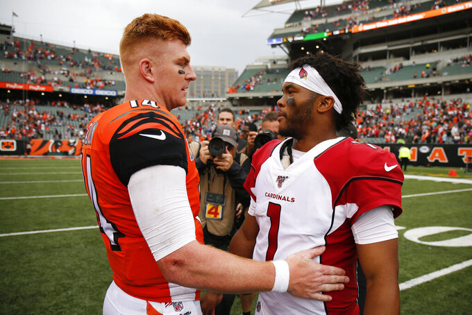 Arizona Cardinals quarterback Kyler Murray (1) meets with Cincinnati Bengals quarterback Andy Dalton, left, after an NFL football game, Sunday, Oct. 6, 2019, in Cincinnati. (AP Photo/Gary Landers)