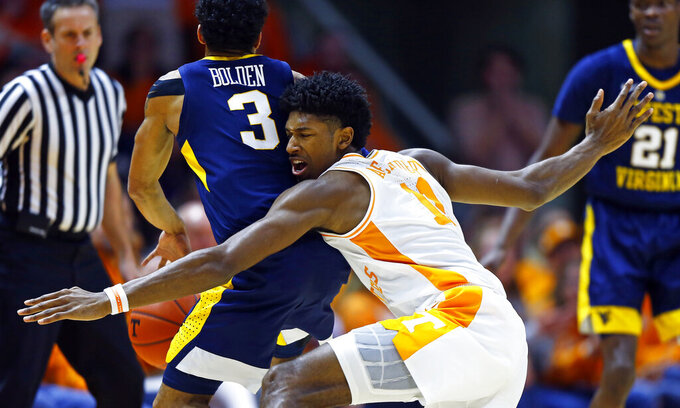 Tennessee forward Kyle Alexander (11) collides with West Virginia guard James Bolden (3) as he attempts to steal the ball in the first half of an NCAA college basketball game Saturday, Jan. 26, 2019, in Knoxville, Tenn. (AP Photo/Wade Payne)