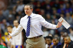 Florida head coach Mike White directs his team during a first round men's college basketball game against Nevada in the NCAA Tournament, Thursday, March 21, 2019, in Des Moines, Iowa. (AP Photo/Charlie Neibergall)