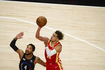 Atlanta Hawks' Trae Young (11) shoots against New York Knicks' Derrick Rose (4) during the first half in Game 3 of an NBA basketball first-round playoff series Friday, May 28, 2021, in Atlanta. (AP Photo/Brynn Anderson)
