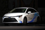 FILE - In this Nov. 28, 2018 file photo,  2019 Toyota Corolla Hybrid is shown during the Los Angeles Auto Show in Los Angeles. In its annual auto reliability survey, Consumer Reports found that while newly redesigned models have the latest safety and fuel-economy technology, they also come with glitches that frustrate owners. Overall, Japanese brands Lexus, Mazda and Toyota led the reliability rankings, followed by Porsche and Genesis. Rounding out the top 10 were Hyundai, Subaru, Dodge, Kia and Mini.  (AP Photo/Chris Carlson, File)