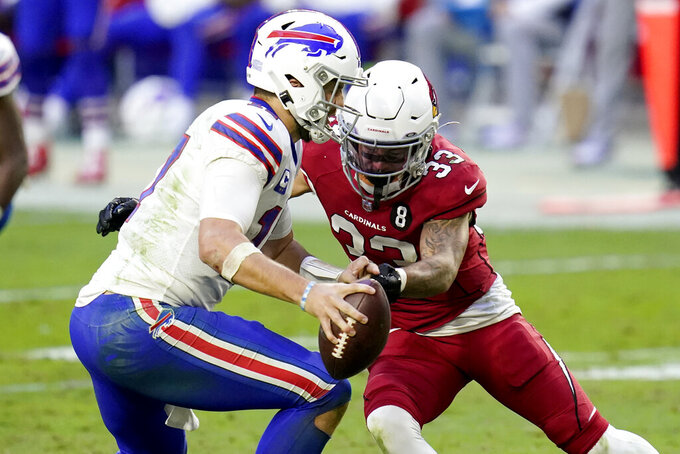 Arizona Cardinals cornerback Byron Murphy (33) pressures Buffalo Bills quarterback Josh Allen during the second half of an NFL football game, Sunday, Nov. 15, 2020, in Glendale, Ariz. (AP Photo/Ross D. Franklin)